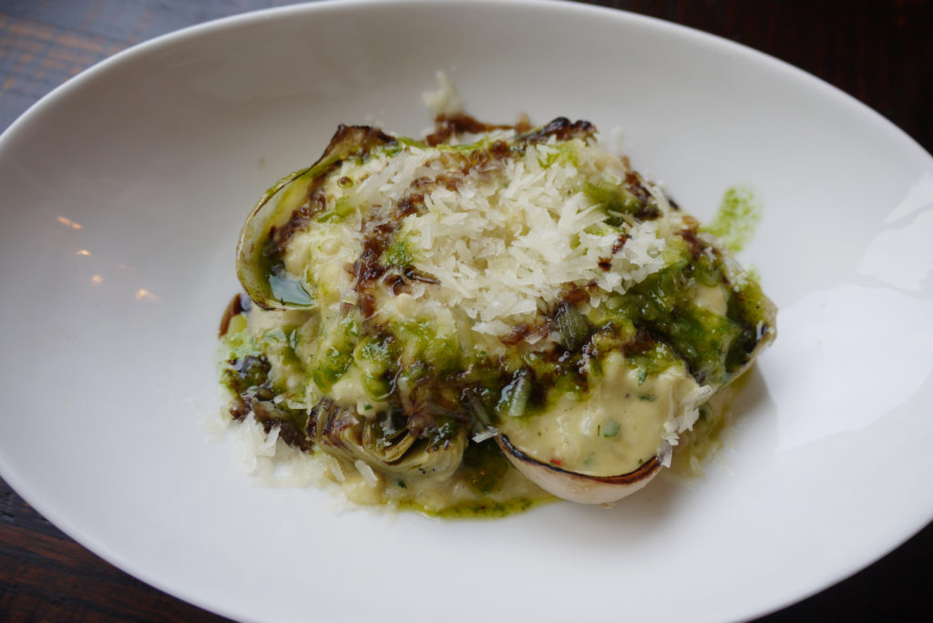Slow roast white onions with chargrilled artichokes and manchego rice