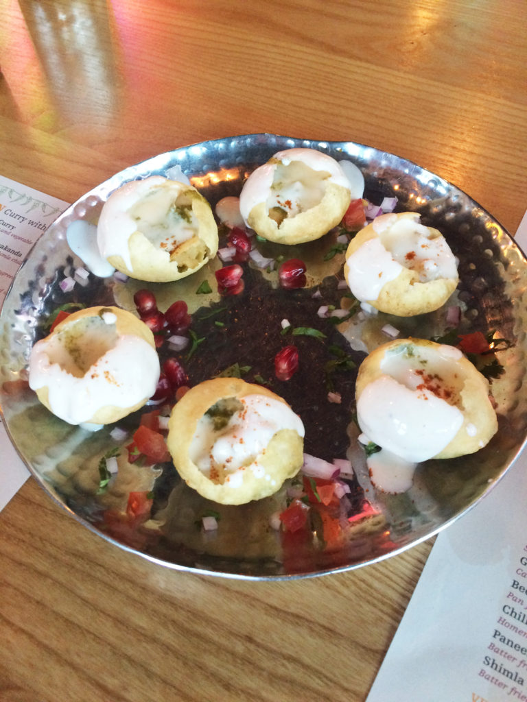 Dahi Puri: Puffed hollow pastry rounds filled with potato and yoghurt