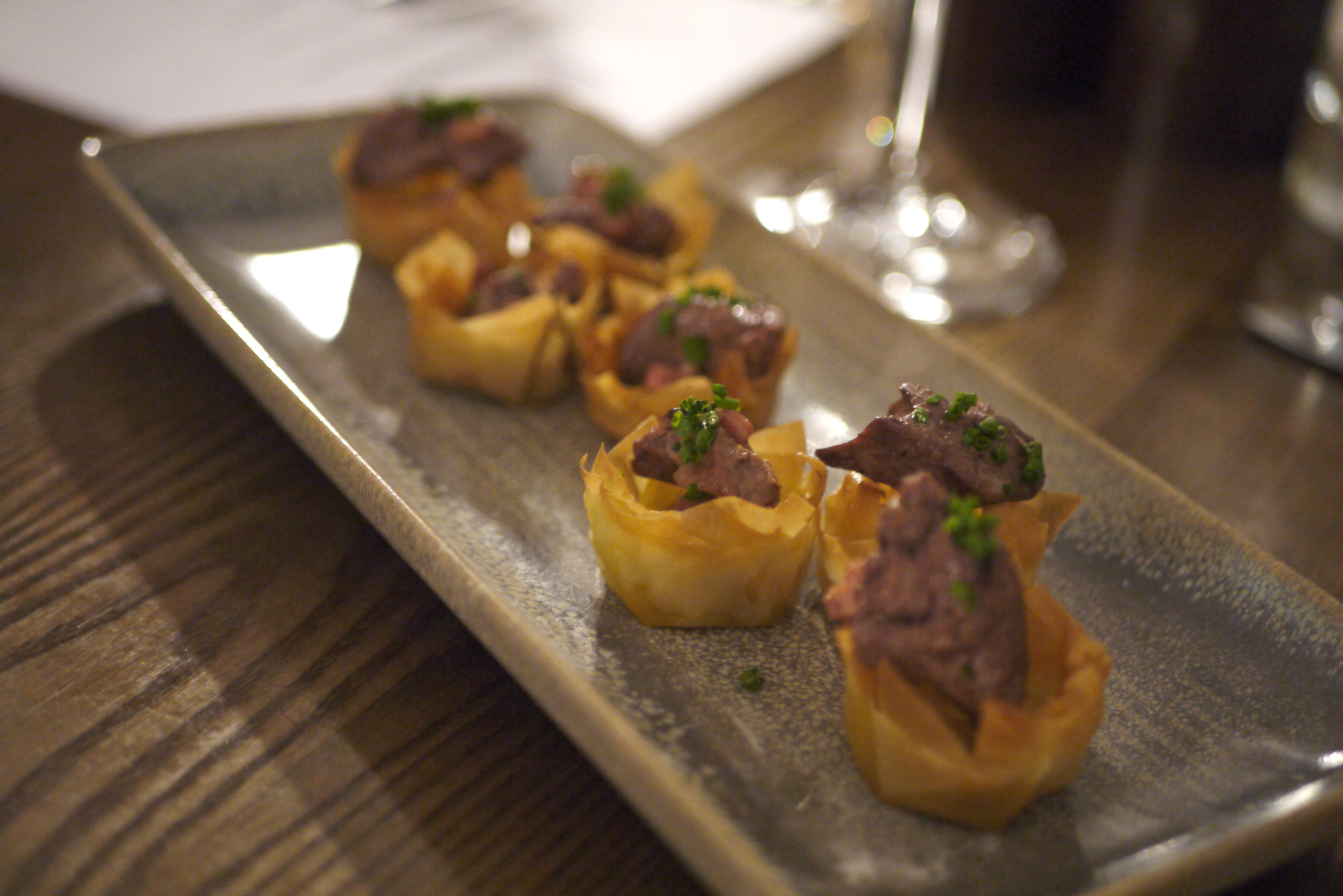 Sauteed chicken livers, smoked bacon in filo pastry